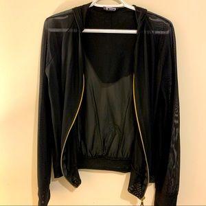 Translucent hooded Black Jacket with golden zipper